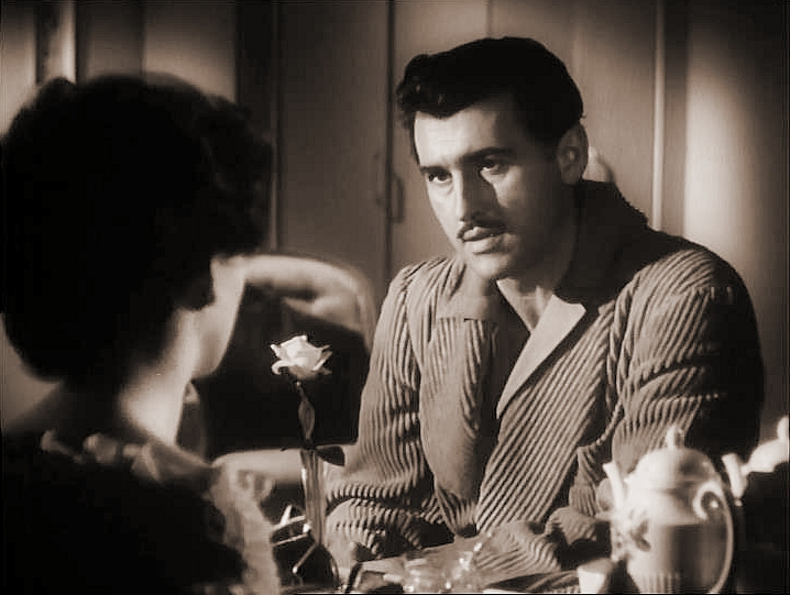 Stewart Granger (as Adam Black) and Jean Simmons (as Evelyne Wallace) in a screenshot from Adam and Evelyne (1949) (3)