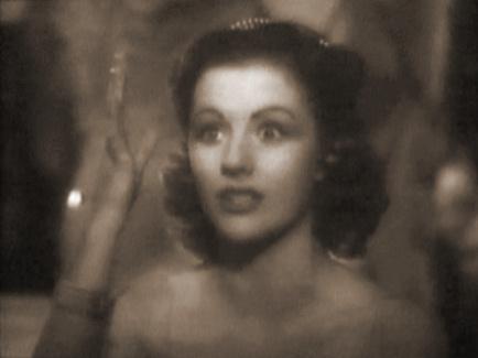 Margaret Lockwood (as Helene Ardouin) in a screenshot from Alibi (1942) (1)