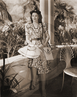Margaret Lockwood as Bedelia sits on the verandah of her hotel.  From the John Corfield production of Bedelia in 1946