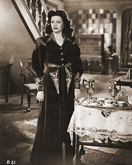 Bedelia (Margaret Lockwood) makes up her mind to confess her past to her husband