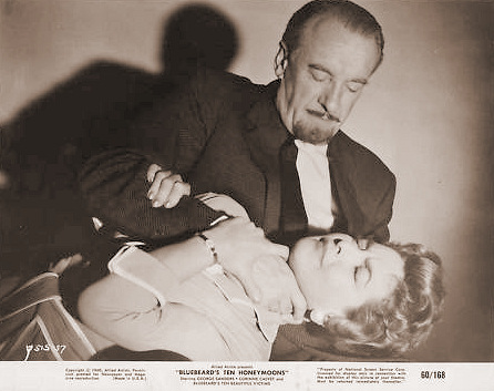 George Sanders (as Landru) and Corinne Calvet (as Odette) in a lobby card from Bluebeard's Ten Honeymoons (1960) (10)