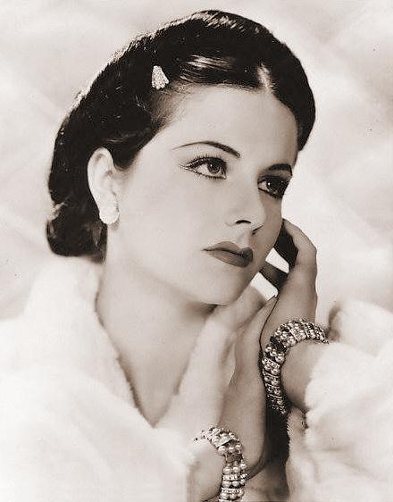Margaret Lockwood wears bracelets and a white fur