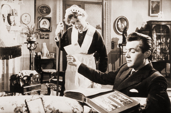 Kathleen Harrison (as Emmie) and Dirk Bogarde (as Edward Bare) in a photograph from Cast a Dark Shadow (1955) (15)