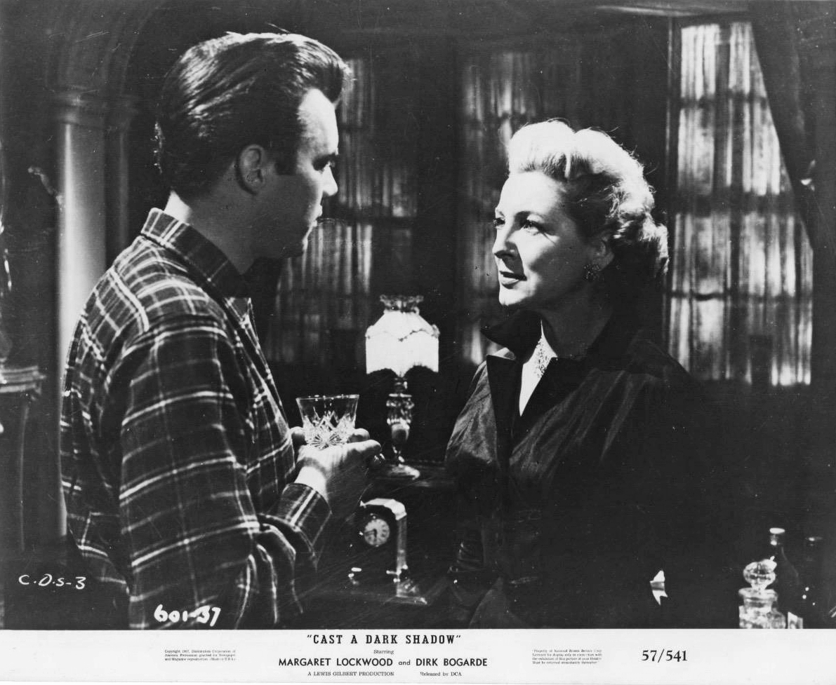 Dirk Bogarde (as Edward Bare) and Kay Walsh (as Charlotte Young) in a photograph from Cast a Dark Shadow (1955) (24)
