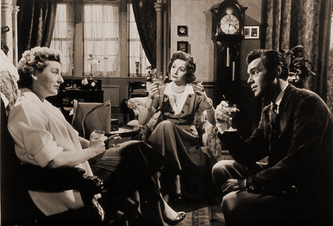 Kay Walsh (as Charlotte Young), Margaret Lockwood (as Freda Jeffries) and Dirk Bogarde (as Edward Bare) in a photograph from Cast a Dark Shadow (1955) (26)