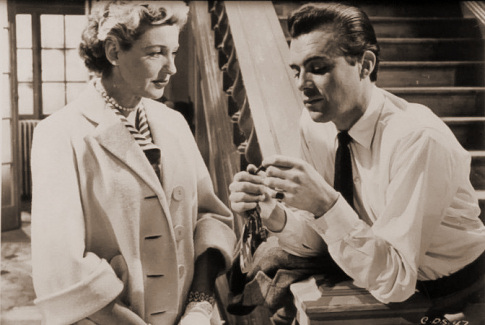 Kay Walsh (as Charlotte Young) and Dirk Bogarde (as Edward Bare) in a photograph from Cast a Dark Shadow (1955) (31)