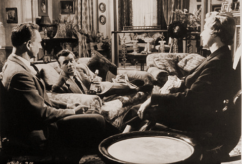 Robert Flemyng (as Phillip Mortimer), Dirk Bogarde (as Edward Bare) and Mona Washbourne (as Monica Bare) in a photograph from Cast a Dark Shadow (1955) (33)