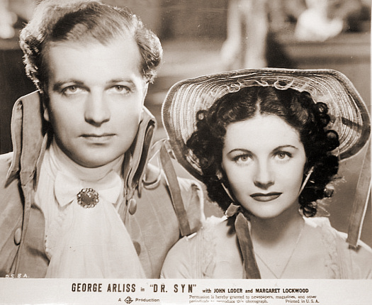 John Loder (as Denis Cobtree) and Margaret Lockwood (as Imogene) in a photograph from Doctor Syn (1937) (5)