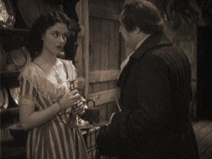 Margaret Lockwood (as Imogene) and Frederick Burtwell (as Rash) in a screenshot from Doctor Syn (1937) (2)