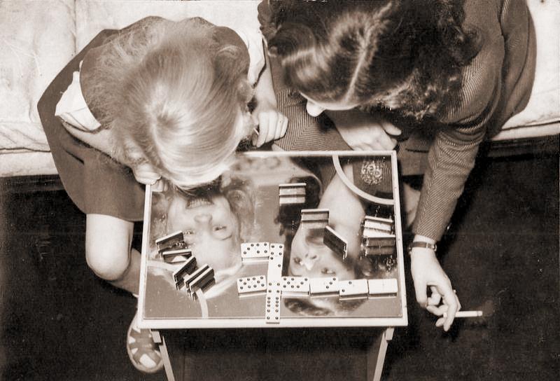 British film star Margaret Lockwood plays dominoes with her daughter Julia Lockwood
