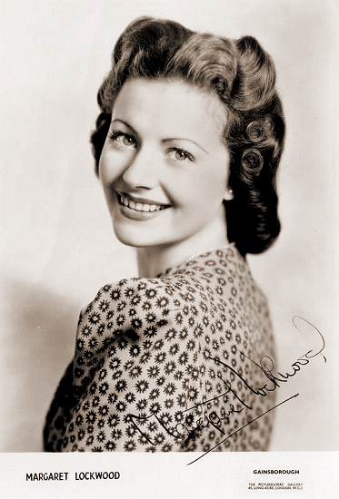 Margaret Lockwood in a spotted dress looks over her shoulder.   From the Gainsborough Gallery