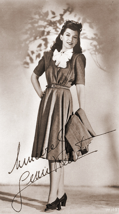 A smart Jean Kent poses for a signed, glamour postcard
