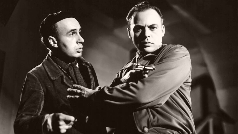 Von Kellerman, alias Keramikos (Herbert Lom) holds a gun in a still from Gainsborough's Snowbound (1948)