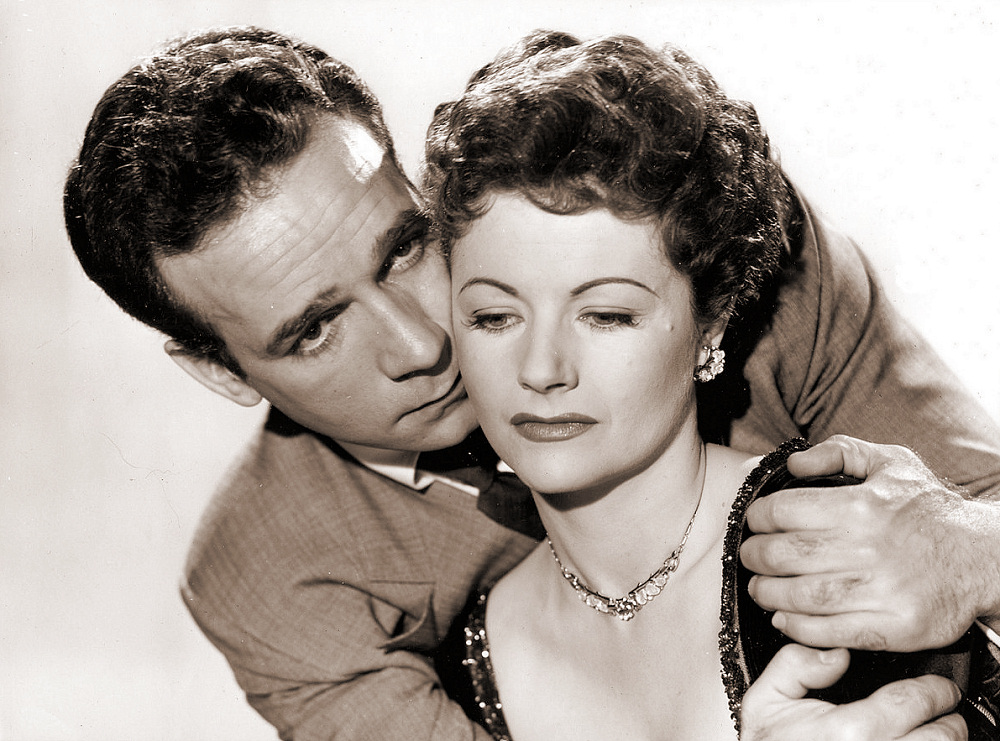 Dane Clark (as Bill Casey) and Margaret Lockwood (as Frances Gray) in a photograph from Highly Dangerous (1950) (16)