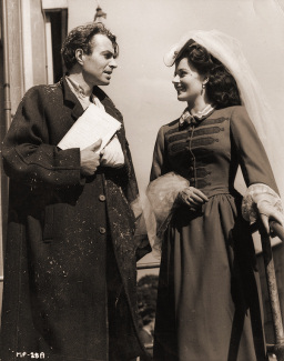 James Mason, on set elsewhere in Odd Man Out, pays a visit to Margaret Lockwood in costume for Hungry Hill