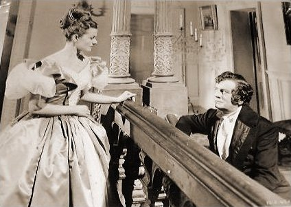 Margaret Lockwood (as Jassy Woodroffe) and Basil Sydney (as Nick Helmar) in a photograph from Jassy (1947) (18)