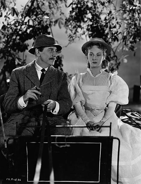 Joan Greenwood (as Wilhelmina Cameron) and André Morell (as Dr. Marshall) in a photograph from Flesh and Blood (1951)