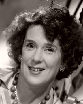 British actress Kathleen Harrison wears a striped blouse