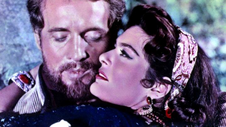 Keith Michell (as Sir Paul Deverill) and Melina Mercouri (as Belle) in a photograph from The Gypsy and the Gentleman (1958)