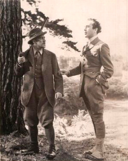 Alec Guinness (as The Duke/ The Banker/ The Parson/ The General/ The Admiral/ Young Ascoyne D'Ascoyne/Young Henry/ Lady Agatha D'Ascoyne) and Dennis Price (as Duke Louis Mazzini/ Mazzini Sr./ Narrator) in a photograph from Kind Hearts and Coronets (1949) (12)