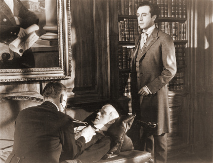 Alec Guinness (as The Duke/ The Banker/ The Parson/ The General/ The Admiral/ Young Ascoyne D'Ascoyne/Young Henry/ Lady Agatha D'Ascoyne) and Dennis Price (as Duke Louis Mazzini/ Mazzini Sr./ Narrator) in a photograph from Kind Hearts and Coronets (1949) (8)