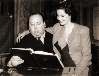 Alfred Hitchcock and Margaret Lockwood (as Iris Matilda Henderson) in a photograph from The Lady Vanishes (1938) (17)