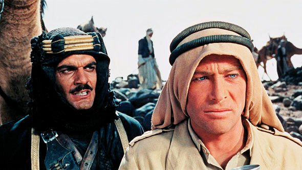 Omar Sharif (Sherif Ali) looks menacingly at the back of Peter O'Toole (T.E. Lawrence)