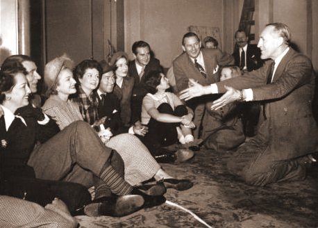 Sitting on the floor, Margaret Lockwood listens to Walter Pidgeon.   Also in attendance are Michael Wilding, Jean Simmons and Valerie Hobson