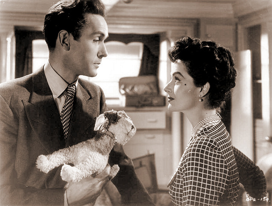 Griffith Jones (as Charles Kent) and Margaret Lockwood (as Ann Markham) in a photograph from Look Before You Love (1948) (1)