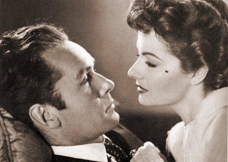 Griffith Jones (as Charles Kent) and Margaret Lockwood (as Ann Markham) in a photograph from Look Before You Love (1948) (12)