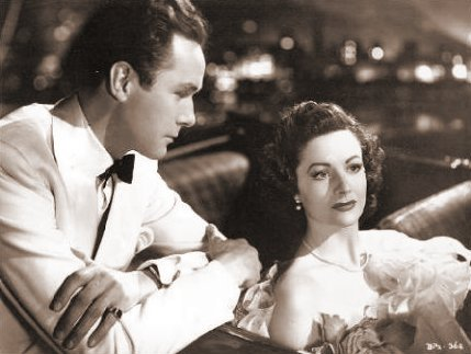 Griffith Jones (as Charles Kent) and Margaret Lockwood (as Ann Markham) in a photograph from Look Before You Love (1948) (8)