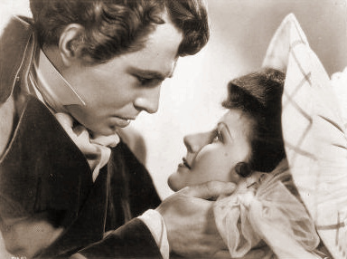 James Mason (as Marquis of Rohan) and Margaret Lockwood (as Hesther Shaw) in a photograph from The Man in Grey (1943) (13)