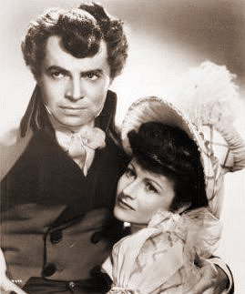 James Mason (as Marquis of Rohan) and Margaret Lockwood (as Hesther Shaw) in a photograph from The Man in Grey (1943) (3)