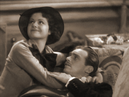 Margaret Lockwood (as Vera Barton) and Douglas Fairbanks Jr (as Tony Woodward) in a screenshot from Man of the Moment (1935) (2)