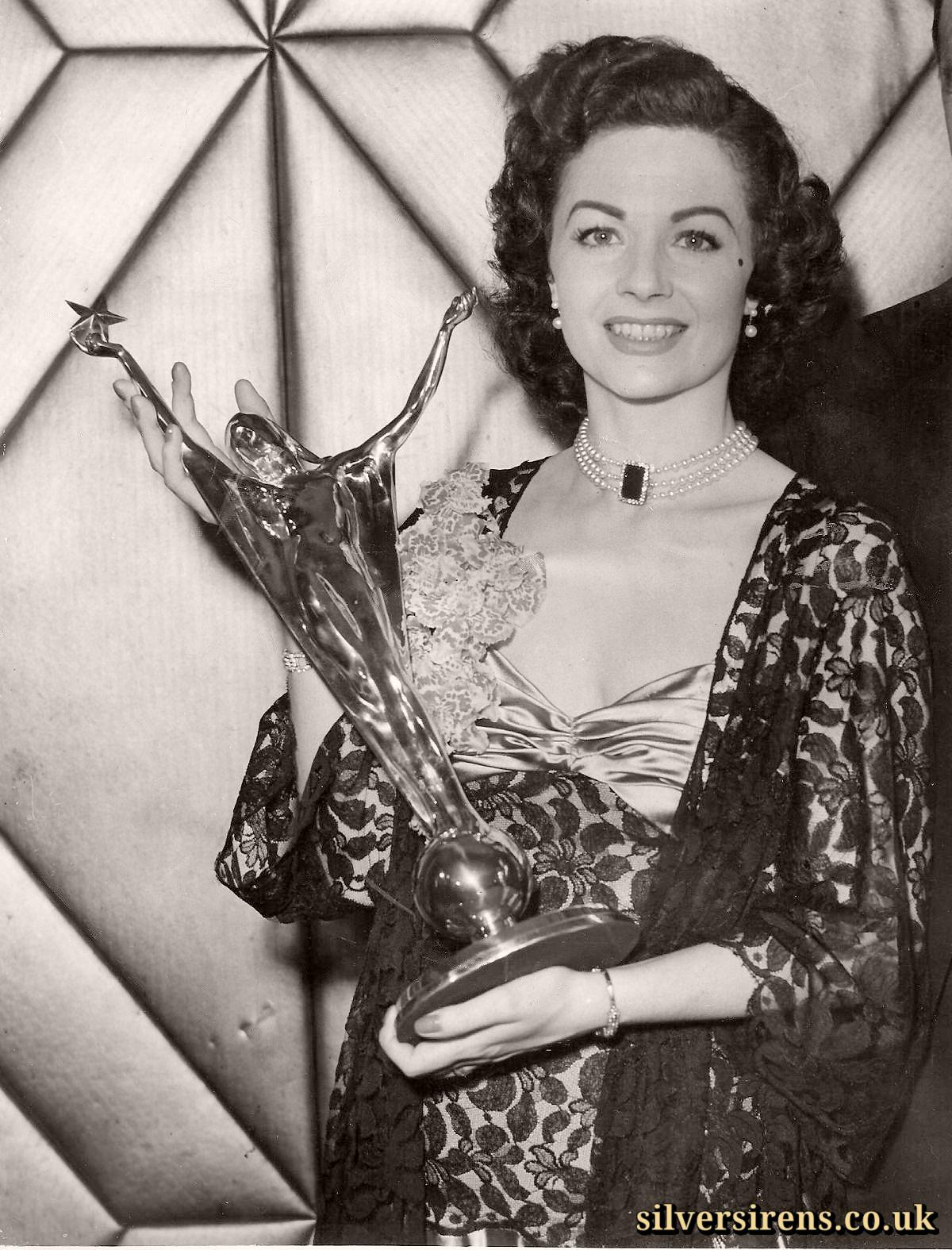 Margaret Lockwood holds her Daily Mail National Film Awards trophy for Best Film Actress of the Year