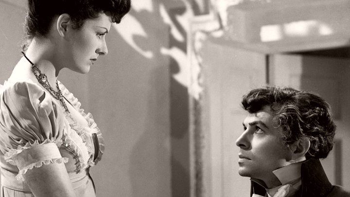 Hester (Margaret Lockwood) and the Marquis of Rohan (James Mason) exchange looks in The Man in Grey