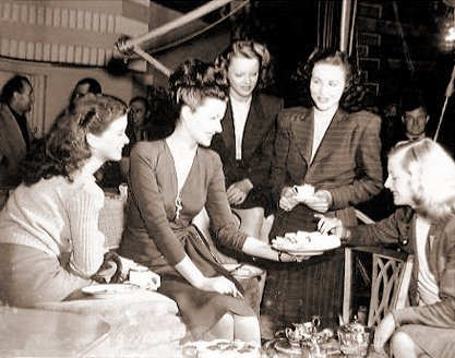 Margaret Lockwood passes round the cakes during a break from filming The White Unicorn