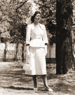 Margaret Lockwood in opera gloves enjoys a sunny day in the park