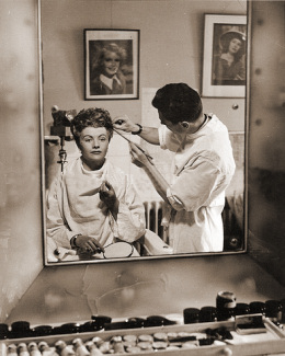 Margaret Lockwood's reflection in the mirror while she is sat backstage in the make-up chair