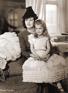 Margaret Lockwood sits daughter Julia Lockwood on her knee