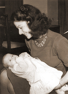 Margaret Lockwood cradling her newborn daughter, Julia Lockwood