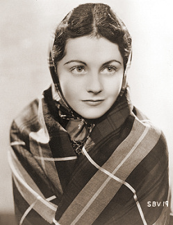 Margaret Lockwood wrapped in a shawl