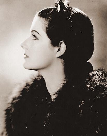 Margaret Lockwood wears a fur stole