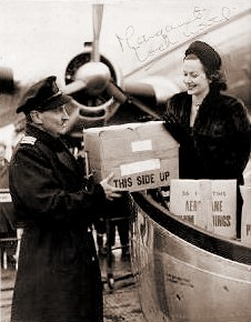Margaret Lockwood supervises the loading of her luggage aboard a BOAC plane