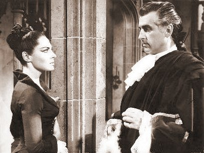 Viveca Lindfors (as Mrs Minton) and Stewart Granger (as Jeremy Fox) in a photograph from Moonfleet (1955) (6)