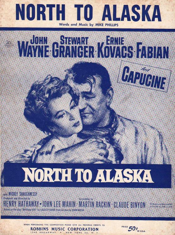 Capucine (as Michelle 'Angel' Bonet) and John Wayne (as Sam McCord) in sheet music from North to Alaska (1960) (1)
