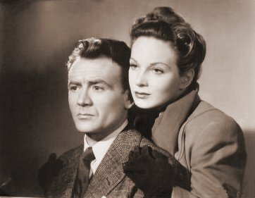 John Mills (as Jim Ackland) and Joan Greenwood (as Jenny Carden) in a photograph from The October Man (1947) (2)