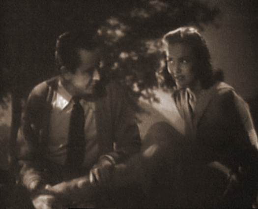 Patricia Roc (as Mary Santell) in a screenshot from One Night with You (1948) (1)