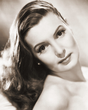Publicity photo of British actress Patricia Roc as she looks over her shoulder at the camera