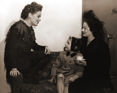 Julia Lockwood and Margaret Lockwood visit Phyllis Calvert backstage while she is appearing in Peter Pan at the Scala Theatre, London in 1947